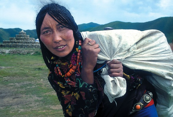 A woman carries her belongings from the higher elevations, to our base at 13,000 feet Plateau of Tibet.
