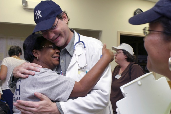 GULFPORT, MS -- SEP 9. 2005: GULFPORT, MS -- SEP 9, 2005: DR. Alan Manevitz, psychiatrist from New York, New York, embraces Frances Fields, epidemiology nurse, district two of Tupelo, Mississippi. Both are members of the Mississippi Emergency Agencies on the gulf coast. Photo: Ana Elisa Fuentes for the New York TImes.