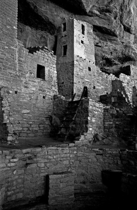 "Anasazi ruins near Durango, Colorado. Photographed on Panatomic-X black and white 35mm film, using a red filter to enhance texture. Below the stairs is the word ""kiva."" A kiva is the portal from which humans were believed to have emerged. photo copyright anaelisafuentes"